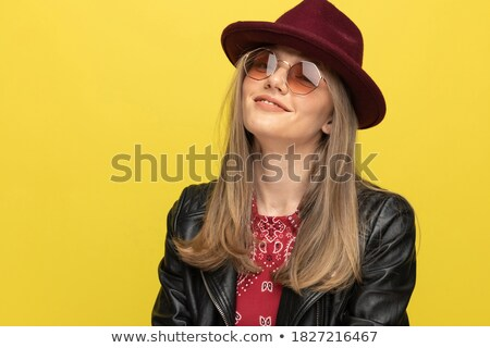 close up of rock woman with yellow sunglasses laughing Stock photo © feedough