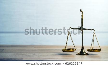 Monedas justicia escala primer plano dorado Foto stock © AndreyPopov