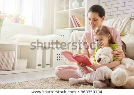 maison · cheminée · heureux · femme · lire · livre - photo stock © choreograph