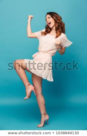 Teljes alakos portré derűs fiatal lány ruha ugrik Stock fotó © deandrobot
