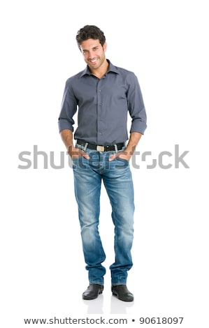 full length portrait of a satisfied young casual man stock photo © deandrobot
