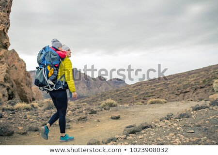 Superhero mother with little boy travelling in backpack Stock photo © blasbike
