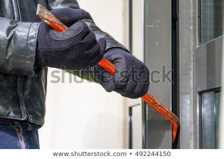 Férfi törik ajtó tolvaj áll mögött Stock fotó © AndreyPopov
