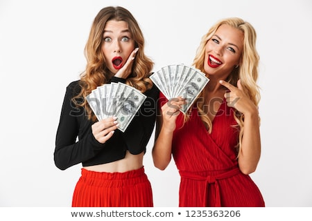 Portrait of two shocked young smartly dressed women Stock photo © deandrobot