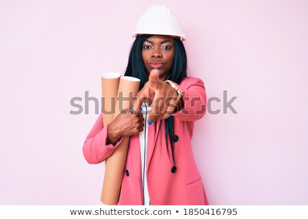 african architect with blueprint pointing at you stock photo © dolgachov