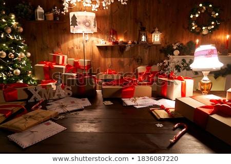 Ajándék vörös szalag kandalló otthon tél ajándék Stock fotó © MikhailMishchenko