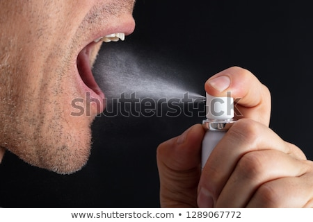 Man Using Mouth Freshener Stock photo © AndreyPopov