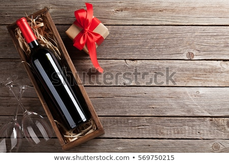 champagne bottle and heart gift box stock photo © karandaev