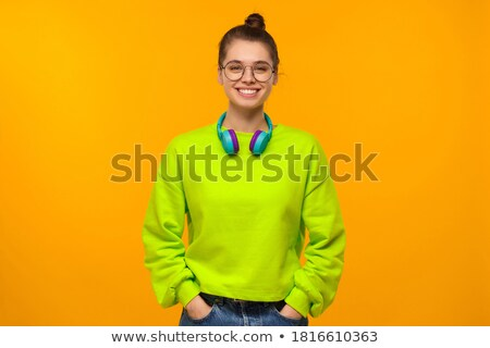 Image of cheerful woman 20s wearing sweatshirt smiling, isolated Stock photo © deandrobot