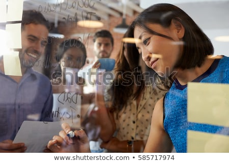 Stock photo: creative team writing on glass board at office