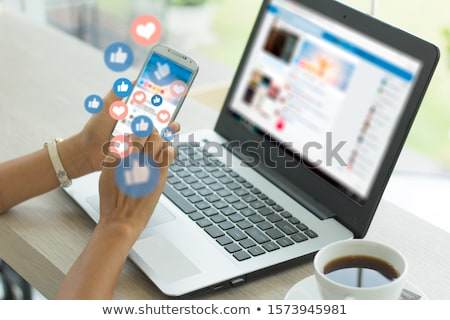 Young person using phone with social media concept Stock photo © ra2studio