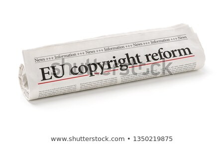 Rolled newspaper with the headline EU copyright reform Stock photo © Zerbor