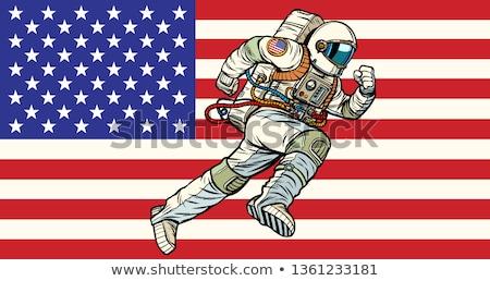 American astronaut patriot runs forward. USA flag Stock photo © studiostoks
