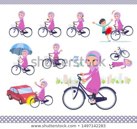Arab Hijab girl_city cycle Stock photo © toyotoyo