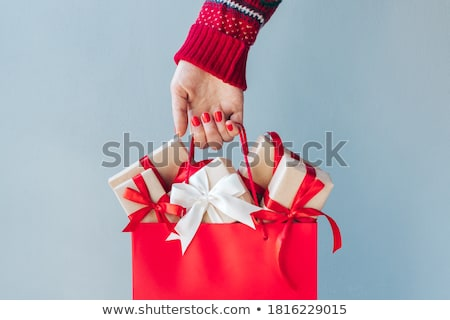 Winter woman holding retail shopping or gift bags Stock photo © lovleah