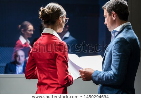Stock photo: Police Detectives Analyzing A Criminal Case Before The Hearing Of A Suspect