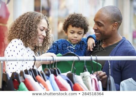 Család néz ruházat sín közelkép mosolyog Stock fotó © Kzenon