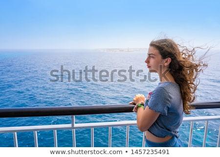 Lány csónak korlát szigetek Spanyolország víz Stock fotó © lunamarina