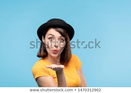 Flörtölő barna hajú lány fekete kalap küldés Stock fotó © pressmaster