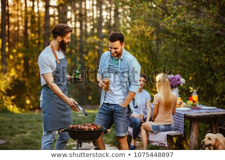 Woman Cooking Outdoor, Picnic on Nature in Summer Stock photo © robuart