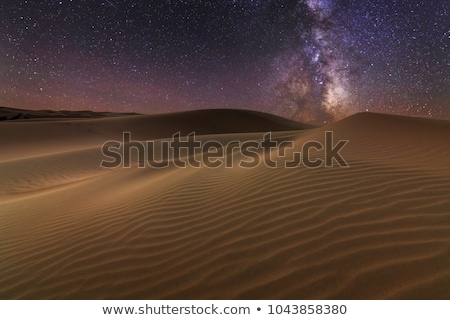 Sand dunes under starry night sky Stock photo © lovleah