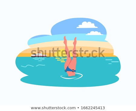 Nő búvárkodik lábak felfelé alámerülés bikini Stock fotó © robuart