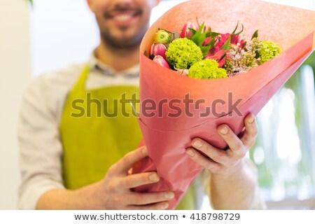 Sorridente florista homem monte Foto stock © dolgachov