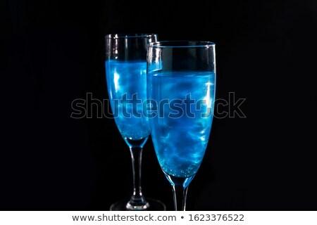 Caída vidrio azul champán cóctel Foto stock © Illia