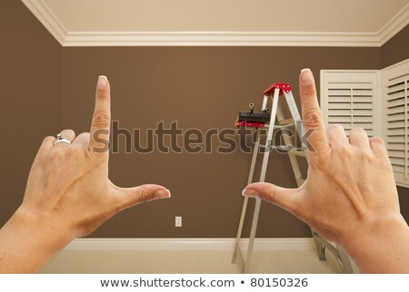 hands framing brown painted wall interior stock photo © feverpitch