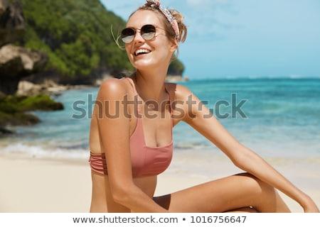 Woman traveler in swimsuit having fun at sandy seashore Stock photo © dash
