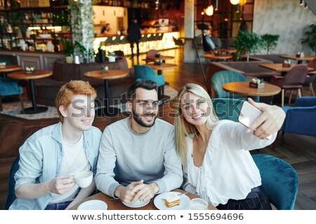 счастливым · сидят · кофейня · портрет - Сток-фото © pressmaster