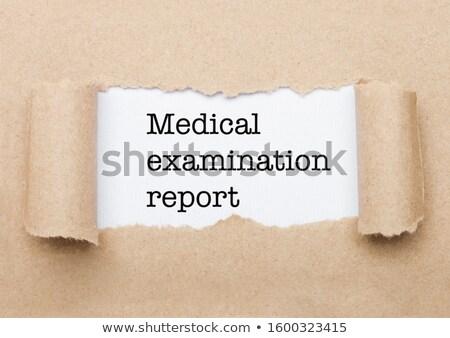 Medical Examination Report text behind paper  Stock photo © DenisMArt