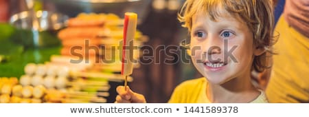Young boy tourist on Walking street Asian food market BANNER, LONG FORMAT Stock photo © galitskaya