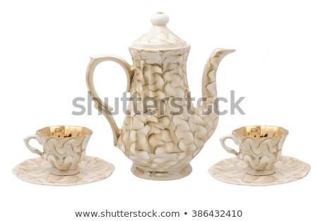 Porcelain teapot with tea Stock photo © Alex9500