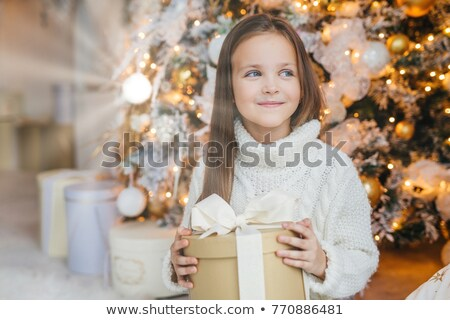 Cute lovely small kid with charming appearance, glad to recieve  Stock photo © vkstudio