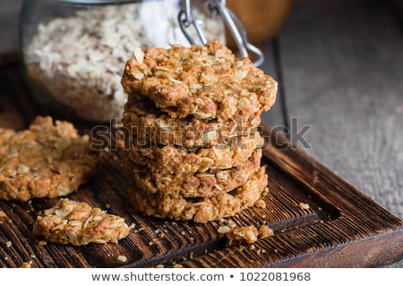 Fresh oat cookies on rustic wooden table background. Stock photo © marylooo