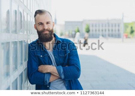 Sakal adam ayakta katlanmış silah portre Stok fotoğraf © yupiramos