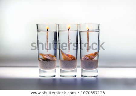 three burning candles and shell stock photo © fotografci