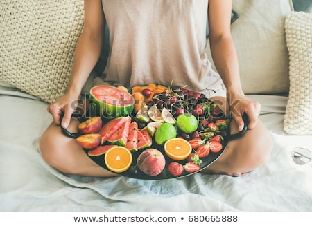 girl on bed eating fruits stock photo © iko