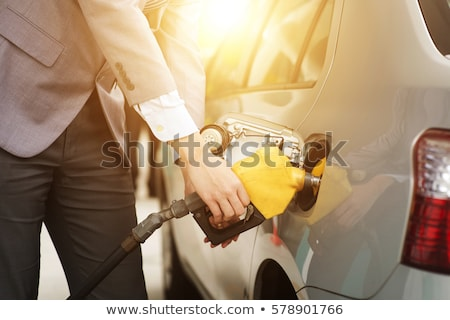 Man filling up a car Stock photo © elenaphoto