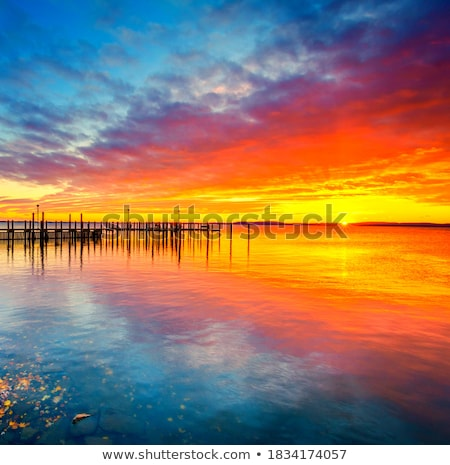 Cloudy sunrise over dock Stock photo © jsnover