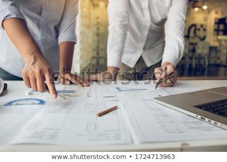 építész tervrajzok tervek tekert felfelé kar Stock fotó © lovleah