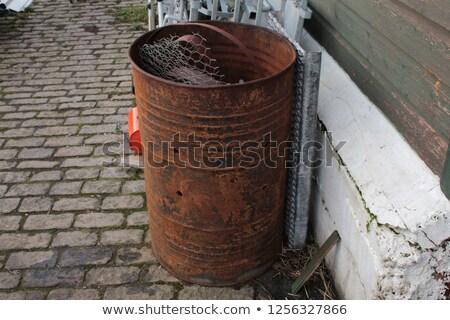 rusty metal barrels stock photo © sirylok