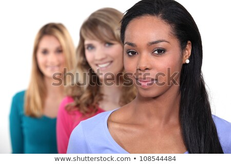 Three female friends stood in a row Stock photo © photography33