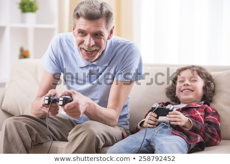Grandfather and grandson with computer Stock photo © photography33