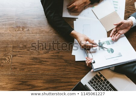 Businessmen discussing a file Stock photo © photography33