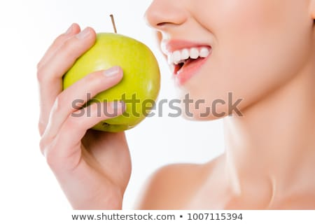 Woman tries to bite a fresh green apple Stock photo © dash