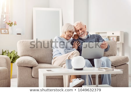 couple looking at a laptop with their grandchildren stock photo © photography33