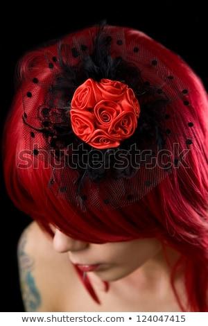Close Up Shot Of Black Hair Fascinator On Red Hair Photo stock © Elisanth