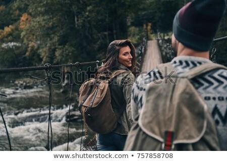 любви пару пешеходный мост женщину точки воды Сток-фото © get4net